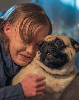 Emma Helphenstine, 15, a sophomore at Kings High School, hugs her support dog Penelope.