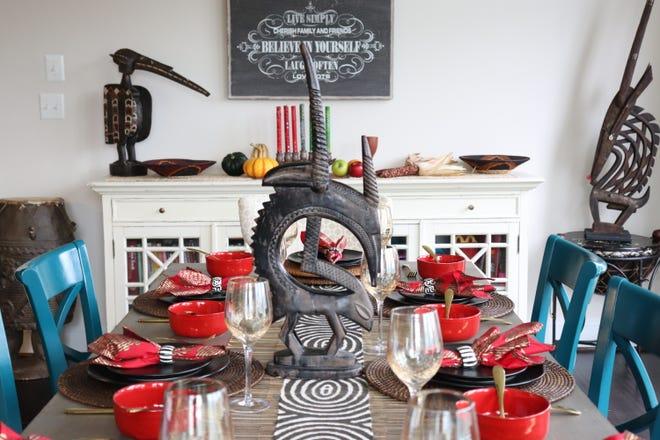 Riche Holmes Grant's table featuring the seven symbols of Kwanzaa.