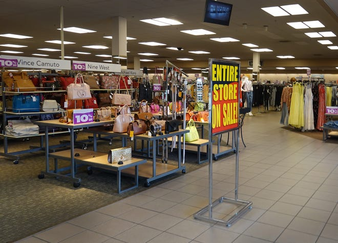 A sign reading, ' Entire Store on Sale,' at the entrance to a Stein Mart store on Aug. 12 in Miami, Florida.