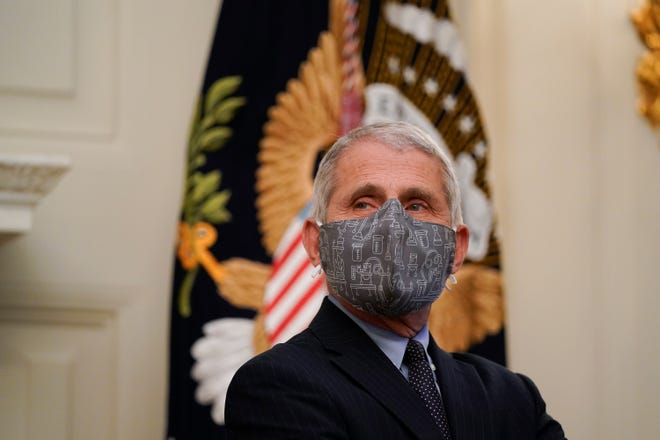 Dr. Anthony Fauci, director of the National Institute of Allergy and Infectious Diseases, listens during an event with President Joe Biden on the coronavirus in the State Dinning Room of the White House, Thursday, Jan. 21, 2021.