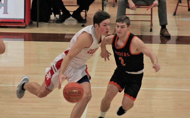 Dixie Heights senior Ian Snelling races upcourt against Ryle junior Connor Bishop as Dixie Heights defeated Ryle 81-64 in KHSAA boys basketball Jan. 8, 2021 at Dixie Heights High School, Edgewood, KY.