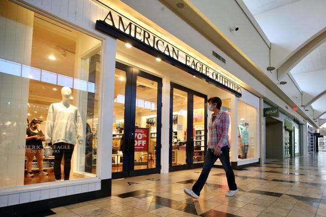 A shopper walks by American Eagle Outfitters inside Florence Mall, Wednesday, May 20, 2020, in Florence, Ky.