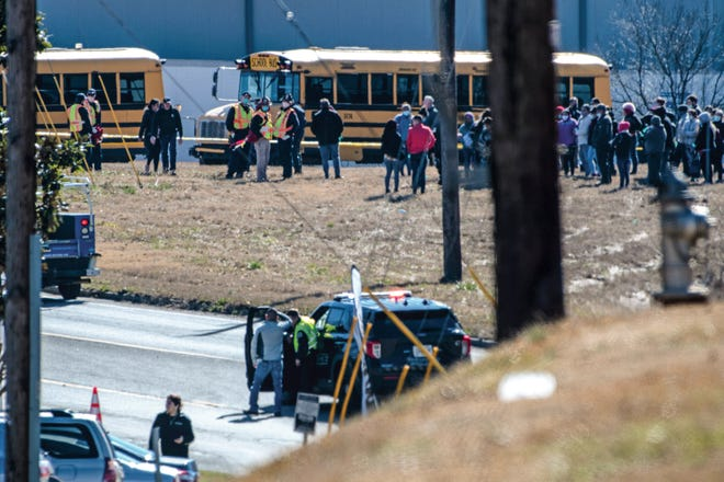 Employees gather outside of the Foundation Food Group site Thursday, Jan 28, 2021, in Gainesville, Ga., following a liquid nitrogen leak that killed six people.
