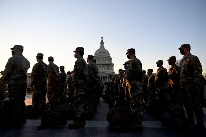 Members of the US National Guard arrive at the US Capitol on January 12, 2021 in Washington, DC.