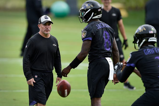 James Urban with Ravens quarterback Lamar Jackson in 2019.