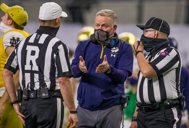 Notre Dame coach Brian Kelly complains to officials during a timeout.