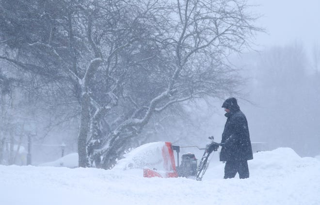 Joel Berman uses a snowblower to clear snow from his driveway Sunday, Jan. 31, 2021 in Bayside, Wis.
