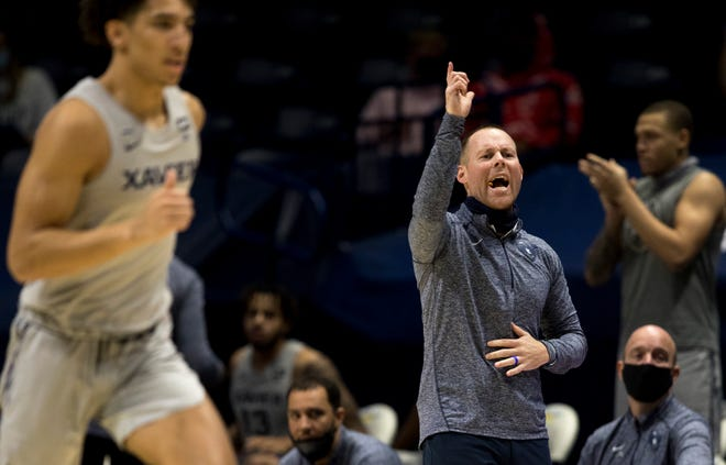 Xavier Musketeers head coach Travis Steele yells out a play in the first half of the NCAA men's basketball game between the Xavier Musketeers and the Seton Hall Pirates on Wednesday, Dec. 30, 2020 at Xavier University in Cincinnati.