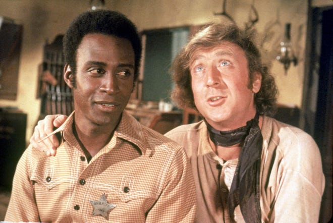 """In the 1974 Mel Brooks comedy """"Blazing Saddles,"""" Gene Wilder (right) teamed with Cleavon Little (left) in the groundbreaking Western spoof."""