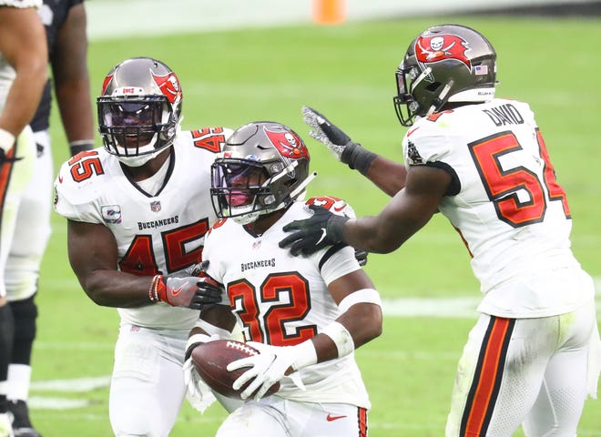 Oct 25, 2020; Paradise, Nevada, USA; Tampa Bay Buccaneers safety Mike Edwards (32) celebrates a play with linebacker Devin White (45) and linebacker Lavonte David (54) against the Las Vegas Raiders at Allegiant Stadium.