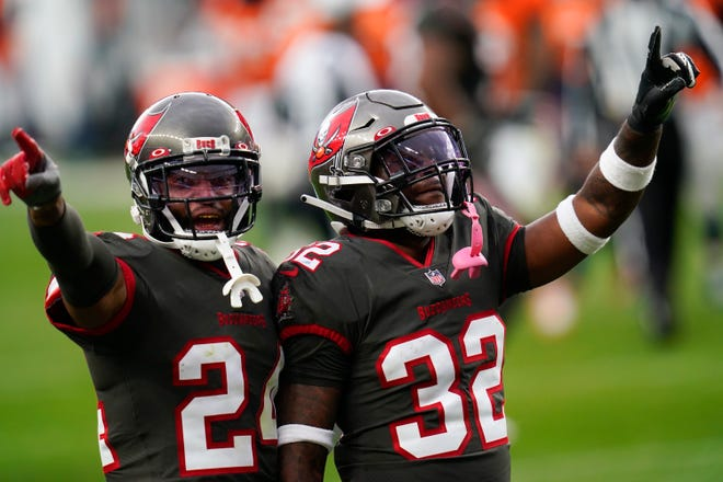 Tampa Bay Buccaneers safety Mike Edwards (32) and cornerback Carlton Davis react during the second half of an NFL football game against the Denver Broncos, Sunday, Sept. 27, 2020, in Denver.