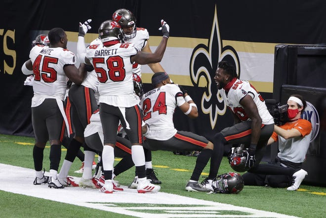 Jan 17, 2021; New Orleans, LA, USA; Tampa Bay Buccaneers safety Mike Edwards (32) celebrates with teammates after an interception against the New Orleans Saints during the fourth quarter in a NFC Divisional Round playoff game at Mercedes-Benz Superdome.