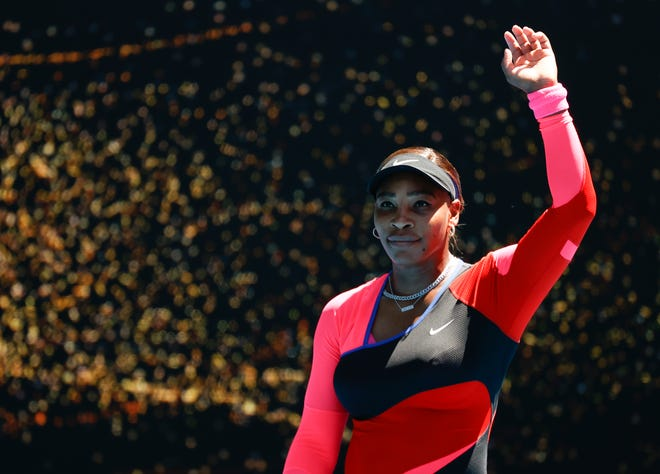 Serena Williams waves after defeating Nina Stojanovic in their second round match at the Australian Open.