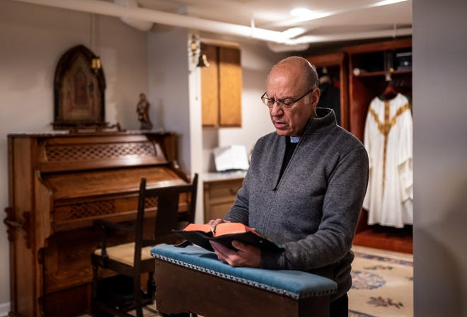 Father Eduard Perrone does his morning prayer on Friday, February 7, 2020.Perrone, a popular Catholic priest who was suspended last summer for alleged child sex abuse, maintains he is innocent and that he was framed by church officials who wanted to get rid of him. His parishioners have filed a lawsuit to get him back, saying a rape claim was fabricated against him and that he deserves to be back in church.