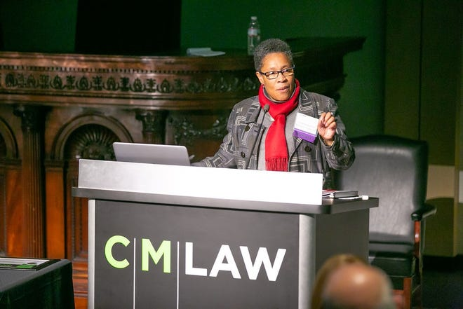 Marcia Fudge gives an acceptance speech at the Cleveland–Marshall College of Law following her induction to the college's Hall of Fame in 2018.