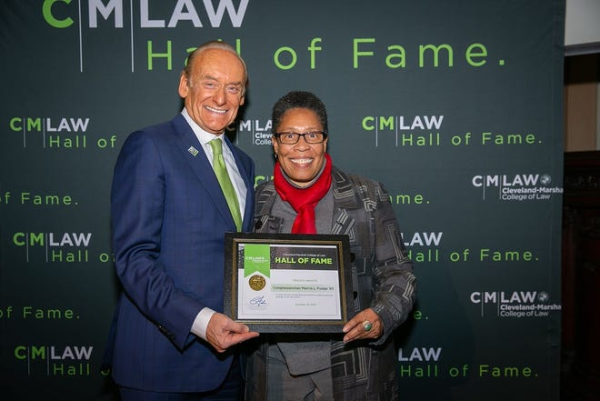 Cleveland–Marshall College of Law Dean Lee Fisher officially inducts Marcia Fudge to the law school's Hall of Fame in 2018.