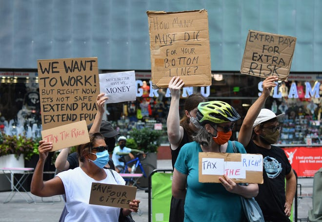 Protesters rally demanding economic relief during the coronavirus pandemic at Time Square on August 5, 2020, in New York City.