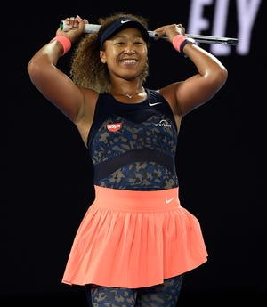 Naomi Osaka reacts after winning a point against Jennifer Brady on the way to her fourth career Grand Slam title.