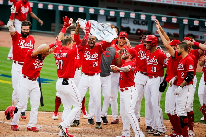 Tyler Stephenson, as a pinch-hitter,  celebrated with his teammates after hitting a two-run home run to beat the Pittsburgh Pirates 3-1 last September at Great American Ball Park.