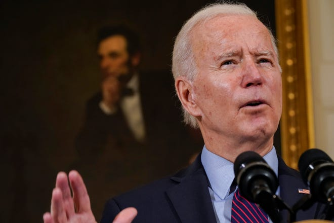 With a portrait of former President Abraham Lincoln behind him, President Joe Biden speaks about the economy in the State Dinning Room of the White House, Friday, Feb. 5, 2021, in Washington.