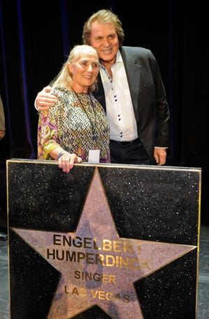 Engelbert Humperdinck and wife Patricia Healey appear with his star at the Paris Las Vegas during Humperdinck's Las Vegas Walk of Stars dedication ceremony on July 20, 2011.