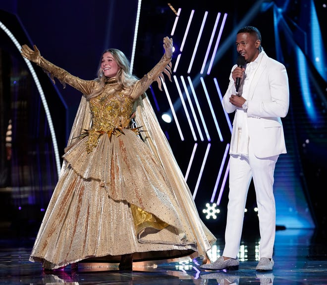 """(L-R) LeAnn Rimes and host Nick Cannon on """"The Masked Singer"""" on Dec. 16, 2020."""