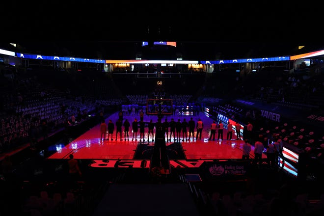 The Providence Friars and the Xavier Musketeers stand as the national anthem is played before tip off of the first half of an NCAA men's basketball game, Sunday, Jan. 10, 2021, at Cintas Center in Cincinnati.