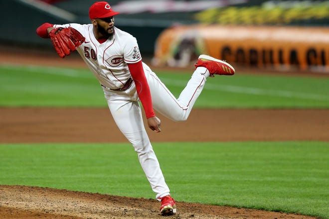Cincinnati Reds relief pitcher Amir Garrett (50) follows through on a delivery in the seventh inning of a baseball game against the Milwaukee Brewers, Monday, Sept. 21, 2020, at Great American Ball Park in Cincinnati. The Cincinnati Reds won, 6-3.