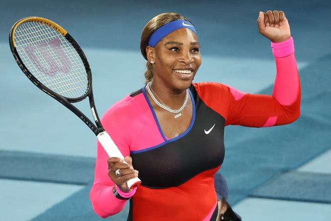 Serena Williams celebrates beating  Simona Halep during their women's singles quarterfinal match during the Australian Open in Melbourne on February 16, 2021.