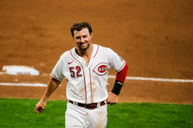 """Kyle Farmer started at shortstop and batted leadoff in the Reds' Spring Training opener against Cleveland on Sunday. """"We want Kyle to get as many at-bats as possible,"""" manager David Bell said."""
