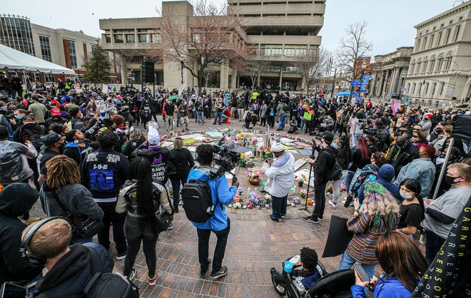 Protesters gathered at Jefferson Square Park on Saturday, March 13, 2021, the one-year anniversary of the killing of Breonna Taylor.