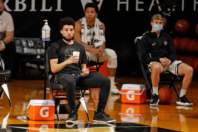 Injured Vanderbilt guard Scotty Pippen Jr. watches the action in the first half of an NCAA college basketball game against Mississippi Saturday, Feb. 27, 2021, in Nashville, Tenn. (AP Photo/Mark Humphrey)