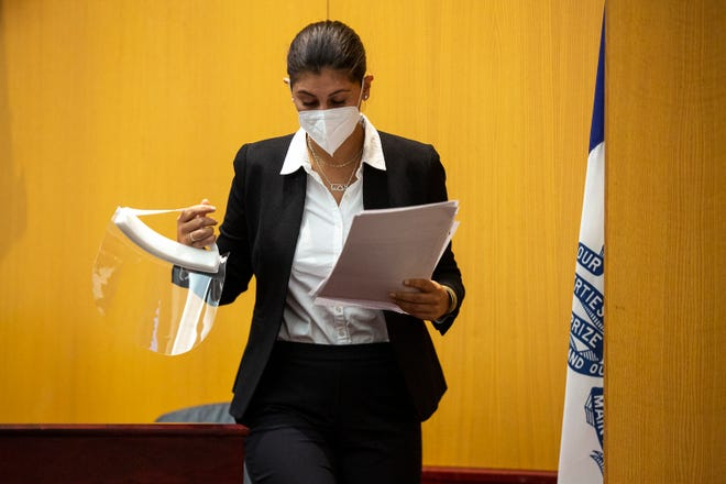 Des Moines Register Reporter Andrea Sahouri leaves the stand after testifying, on Tuesday, March 9, 2021, at the Drake University Legal Clinic, in Des Moines.