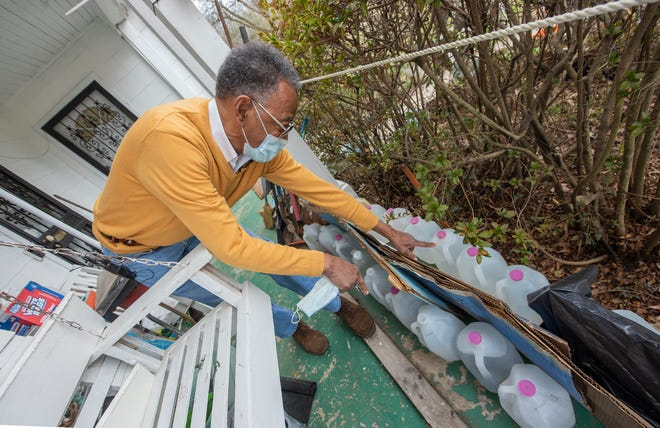 """James Brooks explains about the gallons of water on the front porch of the Jackson, Miss. home. Brooks, a self-declared water hoarder, is no stranger to water issues in the city of Jackson. He has always saved water he explains. It takes a full minute for his hot water to get hot """"I'm going to catch that cold hot water...I paid for it,"""" said Brooks. """"I catch it and it serves for my plants and it comes in handy for the emergency. So, we had plenty of water,"""" he said Friday, March 4, 2021, referring to the recent Jackson water crisis."""