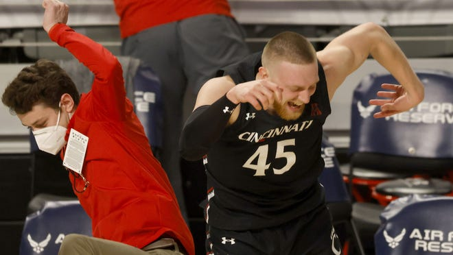 Mason Madsen (45), celebrating Saturday's 70-69 victory over Wichita State, was the only Bearcat who scored in double  figures.