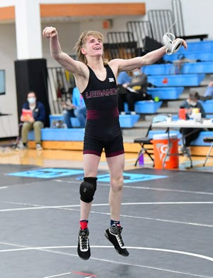 Lebanon's Jack McCall celebrates advancing to the 120 pounds semifinals at the 2021 OHSAA State Wrestling Championships, March 13, 2021.