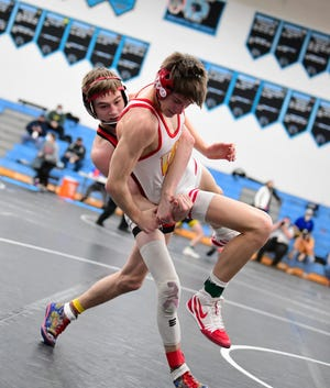 La Salle's Dustin Norris drops Mikey Lewarchick of Wadsworth and moves to the 126-pound state semifinals at the 2021 OHSAA State Wrestling Championships, March 13, 2021.