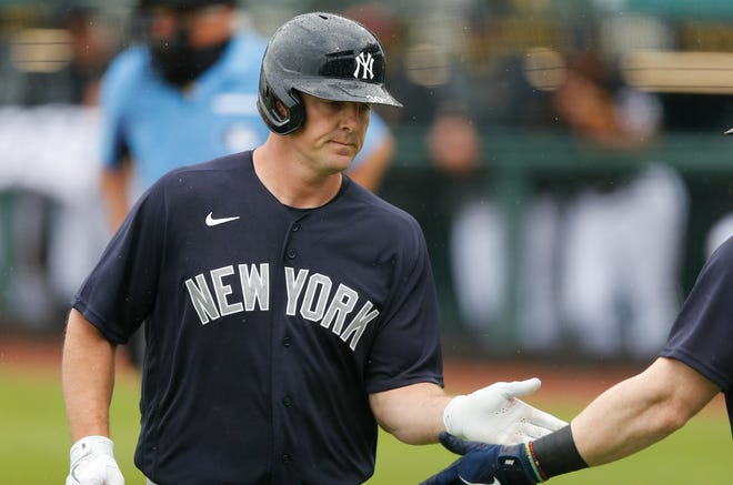Mar 6, 2021; Bradenton, Florida, USA;  New York Yankees Right fielder Jay Bruce (30) hits a home run in the top of the first inning during spring training at LECOM Park. Mandatory Credit: Nathan Ray Seebeck-USA TODAY Sports