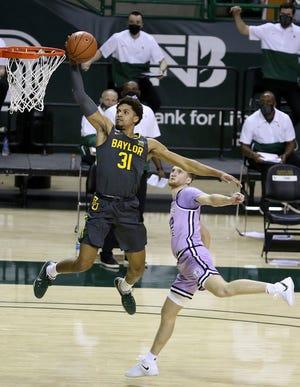 Baylor guard MaCio Teague (31) scores past Kansas State guard Luke Kasubke (22) in the first half of an NCAA college basketball game, Wednesday, Jan. 27, 2021, in Waco, Texas. (AP Photo/Jerry Larson)