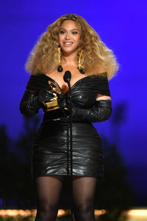 """She made history! Beyoncé accepts the Best R&B Performance award for """"Black Parade"""" onstage during the 63rd Annual GRAMMY Awards."""
