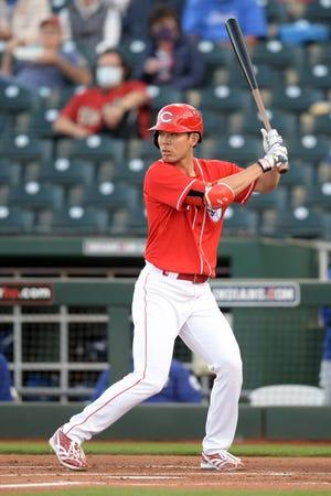 Mar 9, 2021; Goodyear, Arizona, USA; Cincinnati Reds left fielder Shogo Akiyama (4) bats against the Los Angeles Dodgers during the first inning of a spring training game at Goodyear Ballpark.