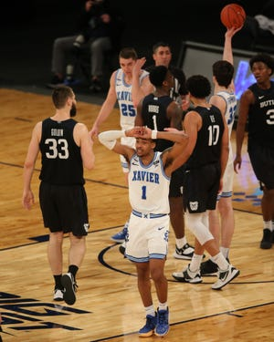 Xavier Musketeers guard Paul Scruggs (1) reacts after being called for a foul during the second half of a Big East conference tournament game against the Butler Bulldogs at Madison Square Garden on March 10.