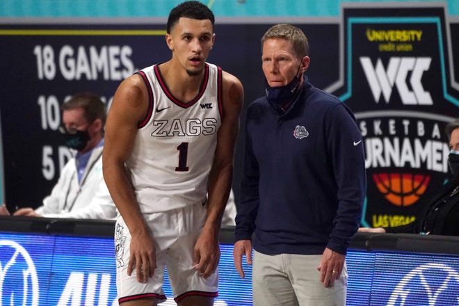 Gonzaga Bulldogs guard Jalen Suggs (1) and head coach Mark Few (R) react during the second half of the West Coast Conference Tournament championship game against the BYU Cougars at Orleans Arena.