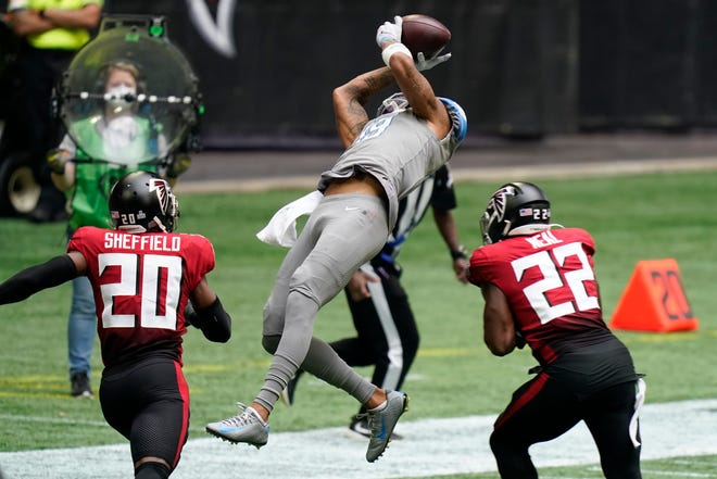 Lions wide receiver Kenny Golladay makes the catch against Falcons strong safety Keanu Neal during the second half on Sunday, Oct. 25, 2020, in Atlanta.