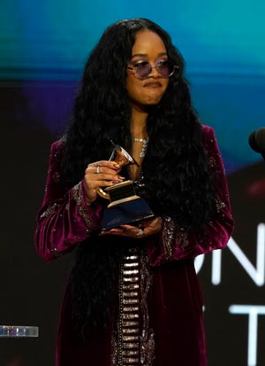 """H.E.R. accepts the award for song of the year for """"I Can't Breathe"""" at the 63rd annual Grammy Awards at the Los Angeles Convention Center."""