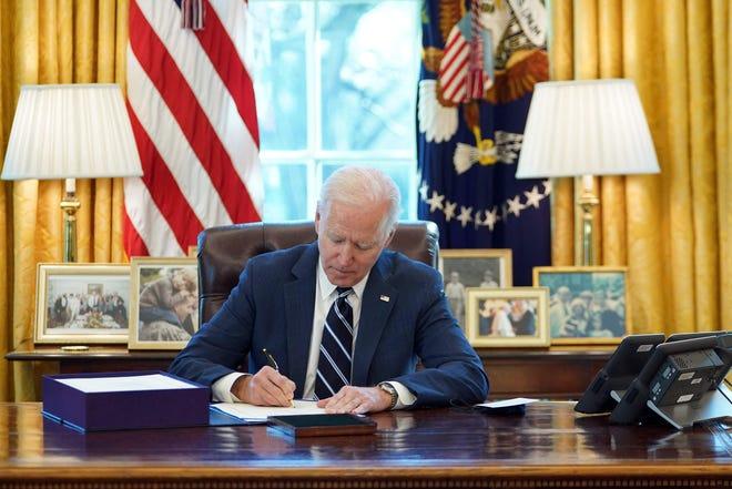President Joe Biden signs the $1.9 trillion American Rescue Plan into law Thursday.