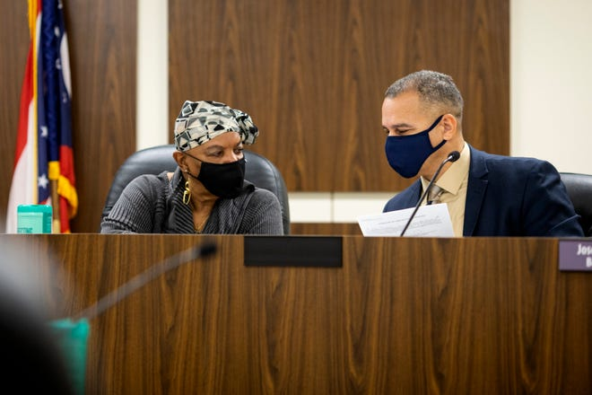 Hamilton County Board of Elections member Gwen McFarlin and Joseph Mallory confer during the Hamilton County Board of Elections meeting on Tuesday, March 2, 2021 in Norwood.