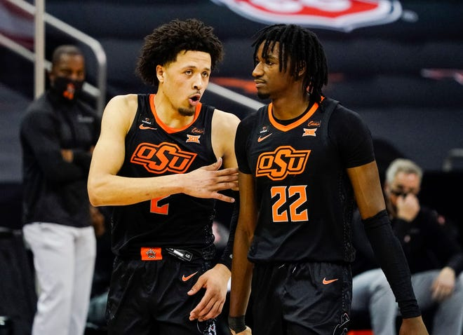Oklahoma State Cowboys guard Cade Cunningham (2) talks with forward Kalib Boone (22) during the first half against the Baylor Bears at T-Mobile Center.