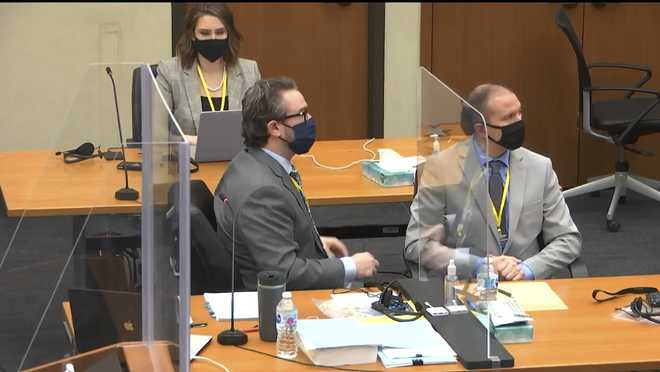 In this image from video, defense attorney Eric Nelson left, and defendant, former Minneapolis police officer Derek Chauvin, right, listen as Hennepin County Judge PeterCahill presides over jury selection in Chauvin's trial, Tuesday, March 9, 2021 at the Hennepin County Courthouse in Minneapolis.