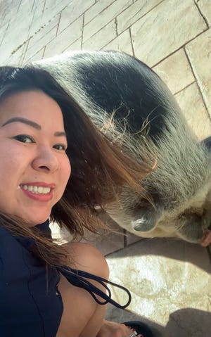 Katherine Price, originally from Vietnam, considers pot-bellied pigs pets as is common in her native country. Arnold is delightfully not ordinary.